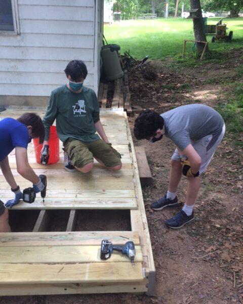 Boy scouts build deck