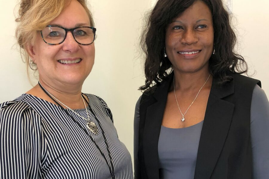 Director of Program Services Maria Dudish welcomes new Deputy Director Caroline Waya